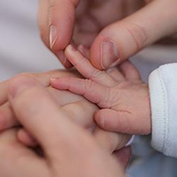 parent-holding-infant-hand2